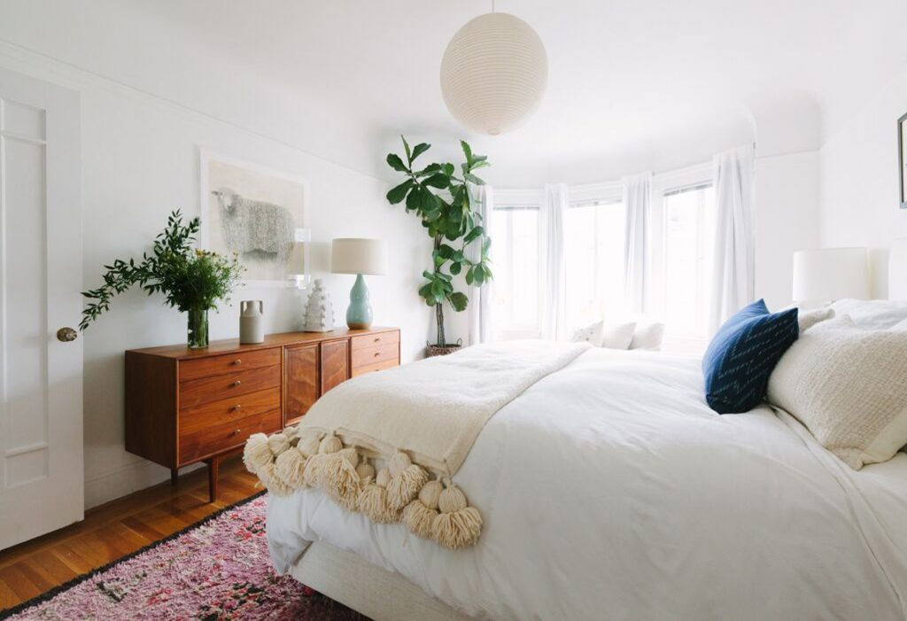 Heidi-Caillier-Design-Seattle-interior-designer-shrader-street-modern-bohemian-mid-century-teak-coffee-table-styling-white-walls-bedroom-pompom-blanket