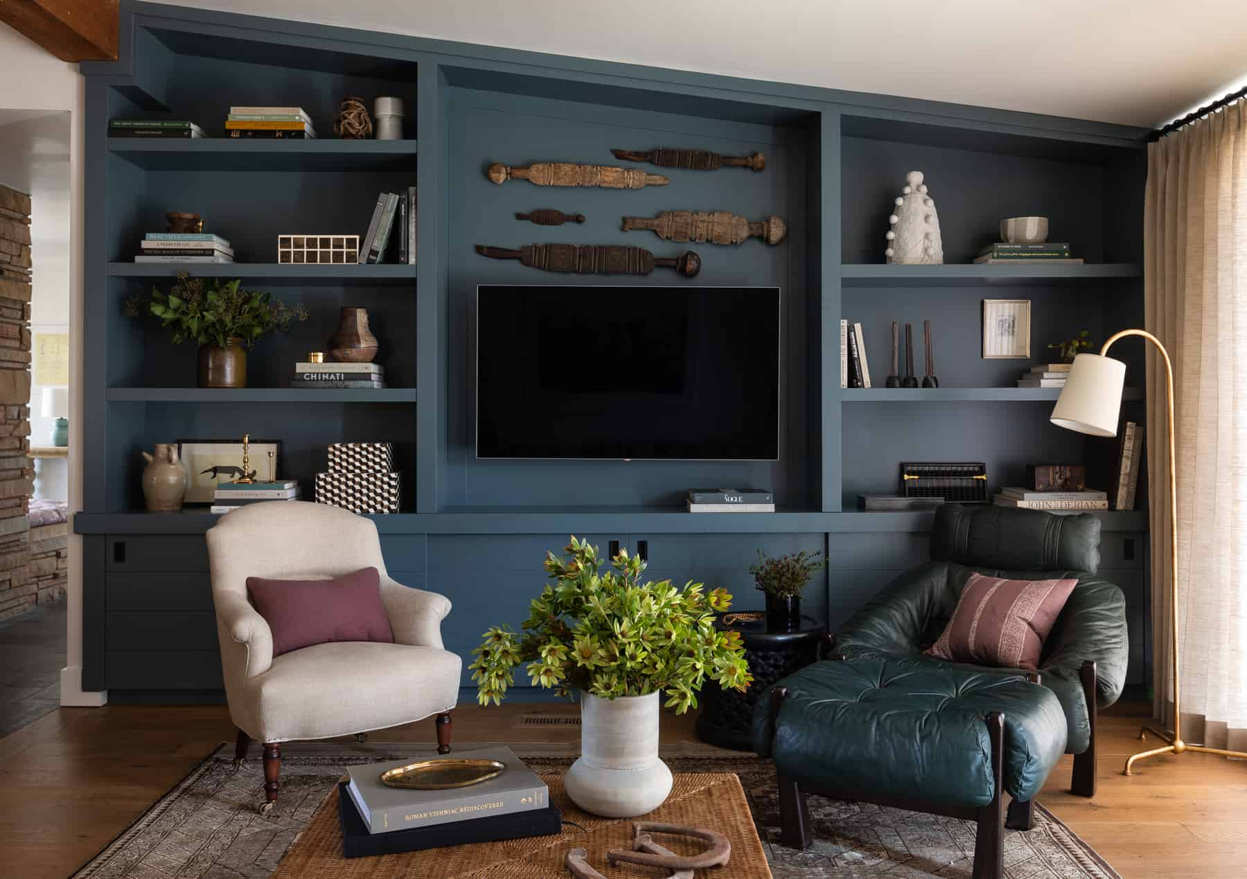 Image of: Heidi Caillier Design Seattle Interior Designer Olympic Manor House Modern Traditional Custom Blue Built Ins Bookshelves Styling Vintage Leather Chair Brass Lamp Drapes Mid Century Tv Heidi Caillier